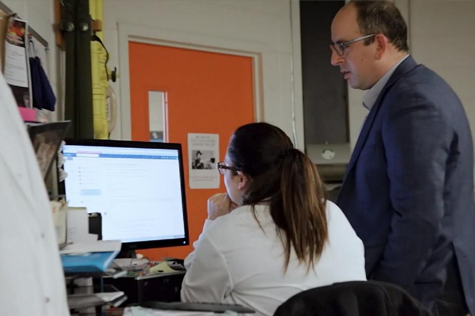 Dr. Nader and student at computer