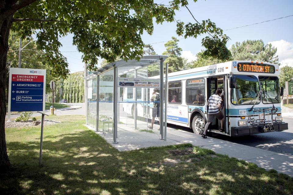 A Kingston City Transit bus stops in front of KGH