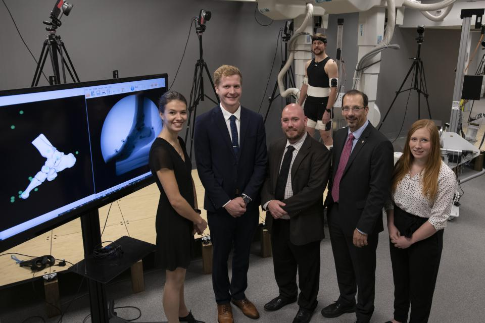 Researcher Dr. Michael Rainbow (centre) and Kevin Deluzio, dean of engineering and applied science, with graduate students (L-R) Lauren Welte, Mitchell Wheatley, Liam Rodgers and Zoe Mack.