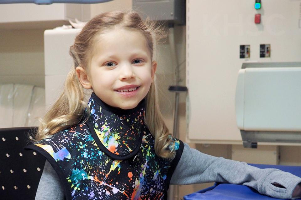 Ella models the new pediatric apron that was inspired by her experience in the Diagnostic Imaging department
