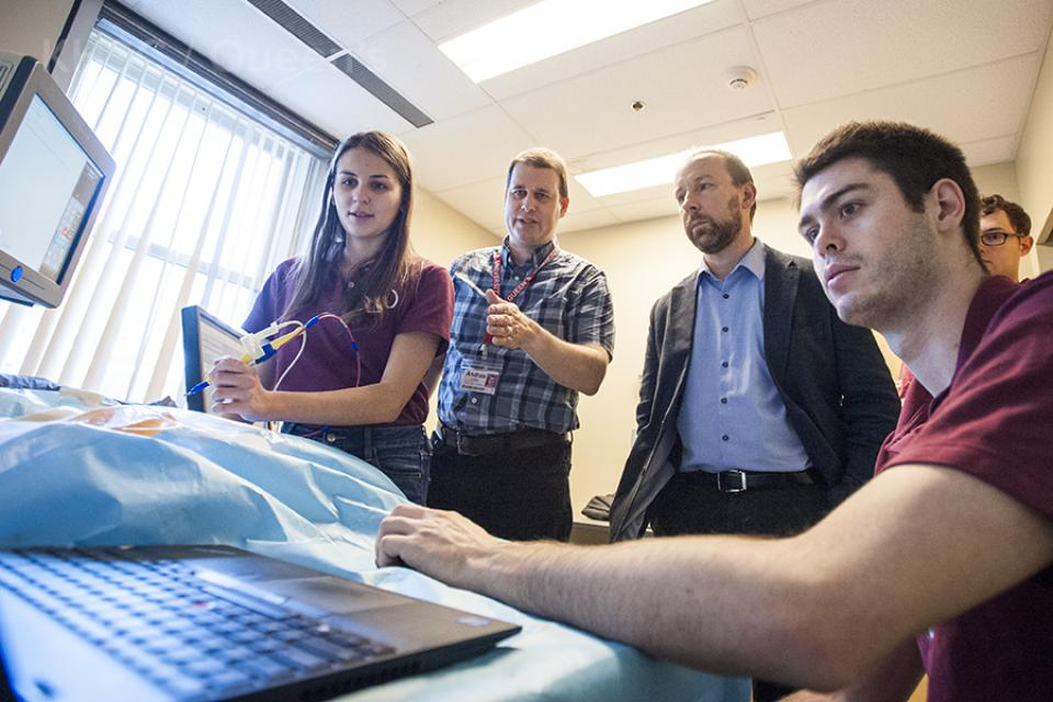 Dr. Zoltan Tataks, inventor of the iKnife receives a demo of the visual mapping technology from the Perk Lab team