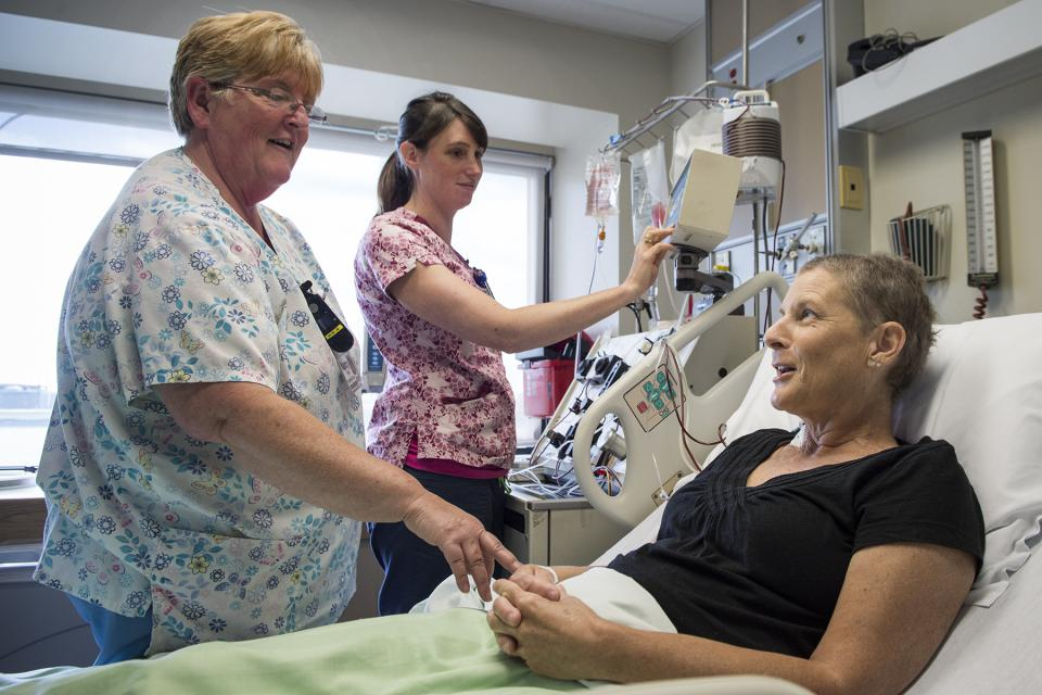 Nurses with a patient receiving a stem cell treatment