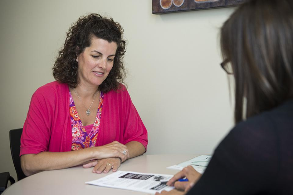 A staff member works with a patient and talks about the various Mental Health Care programs at KGH