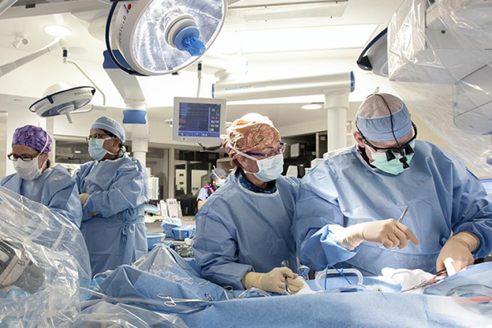 A multidisciplinary surgical care team working in the operating room at KGH.