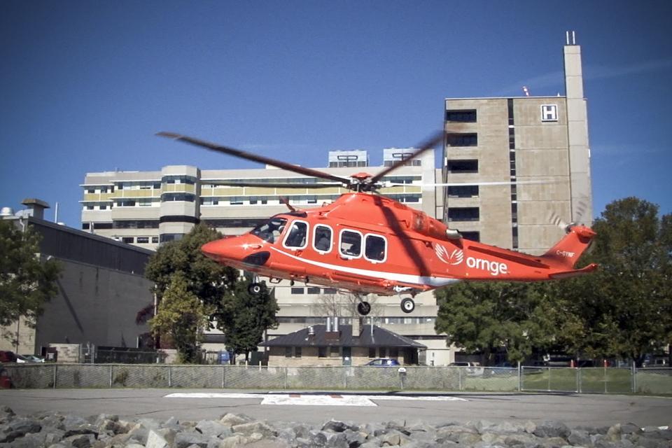 ornge air ambulance landing at the KGH site helipad.