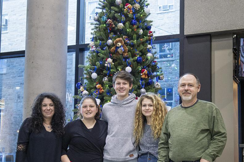 """""""We're hoping that by just seeing the tree or maybe sitting nearby briefly, people will feel their worries ease, even for a few minutes, """" says Don McCullough (far right), posing here with his family (from left): Laura, Gabby, Luca and Lilly."""