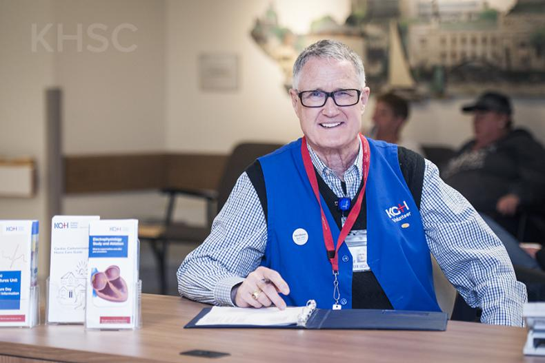 Volunteer Don Cooper greets patients from his post every Wednesday at the Cardiac Care Information Desk at KGH