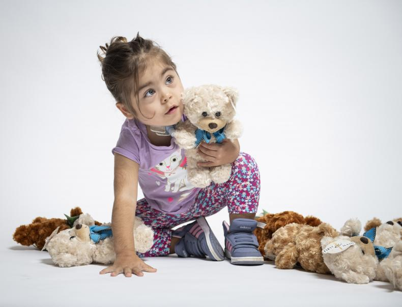 image of child with teddy bears