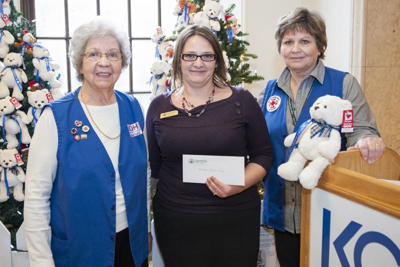Lynn Brown from Kawartha Credit Union in Kingston presents a cheque to KGH Auxiliary campaign organizers during the kick off event.