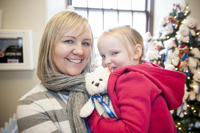 """Five-year old patient Aly Davis and her mother Audrey Jones stopped by the Watkins lobby to help launch this year's """"Show Children You Care"""" Teddy Bear campaign."""
