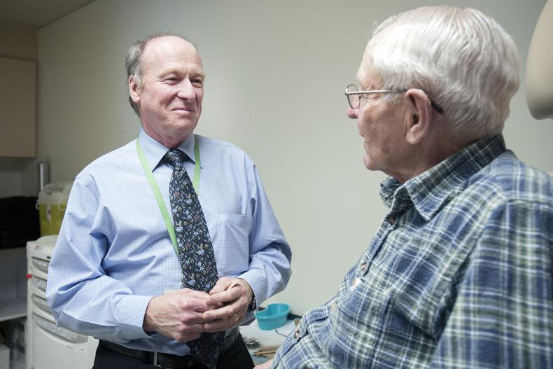 Doctor speaking with patient, follow up appointment, cancer care
