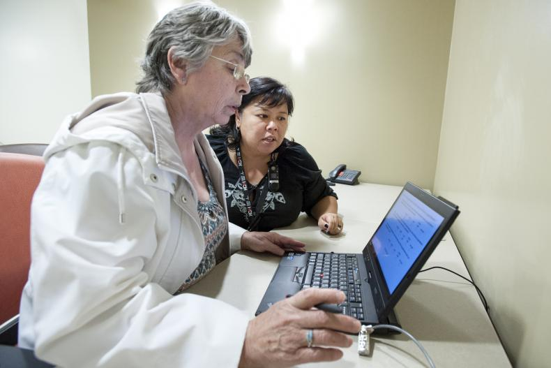 Nurse helping patient, follow up appointment, cancer care, evaluation