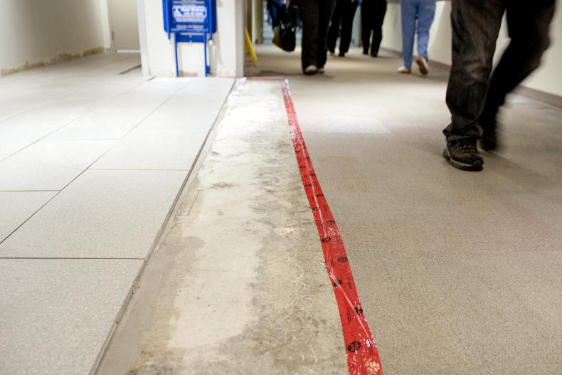 KGH markings for new carpet replacement on the floor
