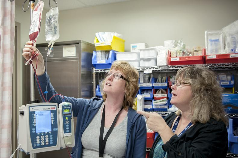 Transfusion Safety Officer Beverly Weaver (right) and Registered Nurse Suzanne Bashall discuss a blood transfusion being performed in our Post Anaesthetic Care Unit.