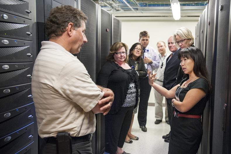 Peng-Sang Cau, one of three new KGH Board members joining the board this year, learns about some of the IT infrastructure projects completed recently.