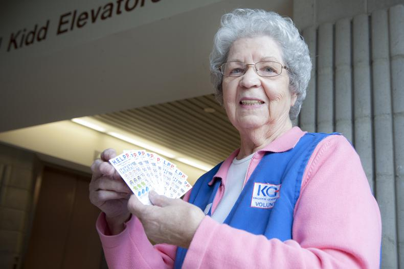 Auxiliary member Alice Roberston sells HELPP lottery tickets.
