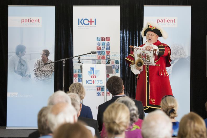Kingston Town Crier Chris Whyman helps spread the news about KGH's anniversary.
