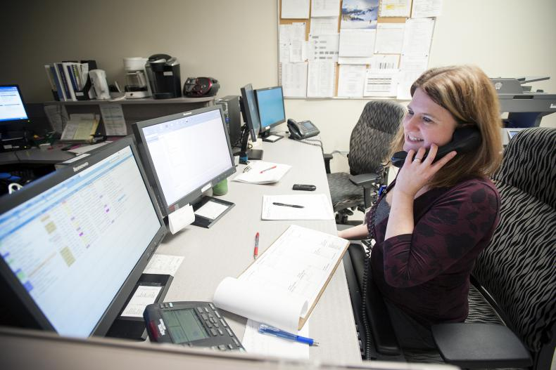 Registration Clerk Amiedawn Esford can now assign inpatient beds using the Emergency Department Information System (EDIS) instead of waiting for a paper form to arrive.