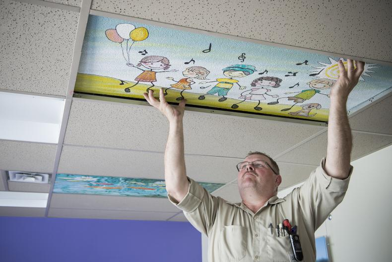 Doug Kennedy, Mechanic, was busy installing the nine ceiling tiles now up in the Pediatrics unit.
