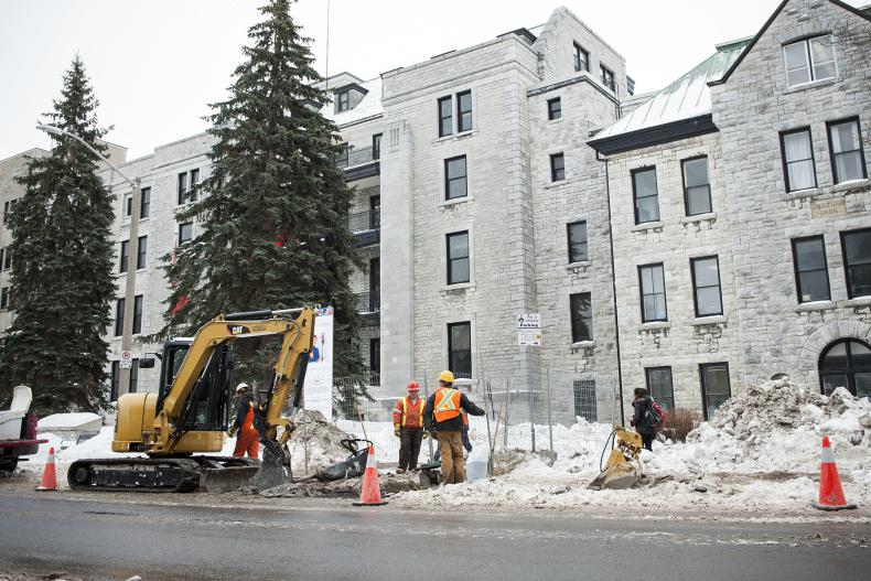 Call it a sign of things to come. A construction crew works on Stuart Street a few months ahead of the infrastructure renewal project set to go this spring.