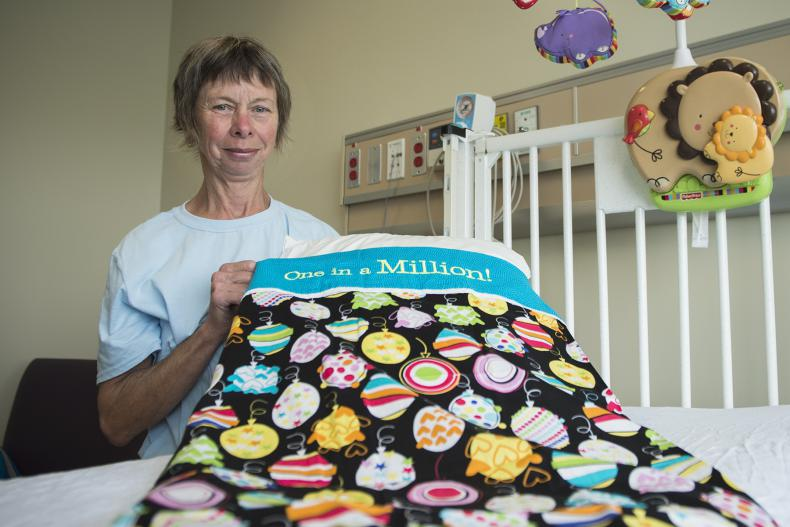 Liz Withers from Ryan's Case for Smiles celebrates the donation of the charity's one millionth pillowcase at KGH