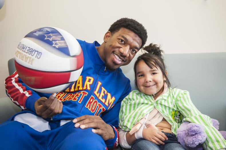 """Harlem Globetrotter Anthony """"Buckets"""" Blakes visited KGH's Pediatrics unit before a game at the K-Rock Centre"""