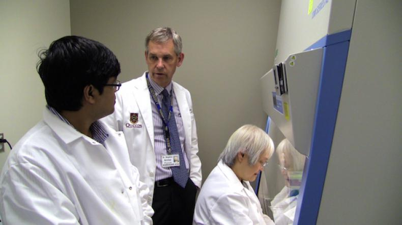 Dr. Archer with his colleagues in the lab