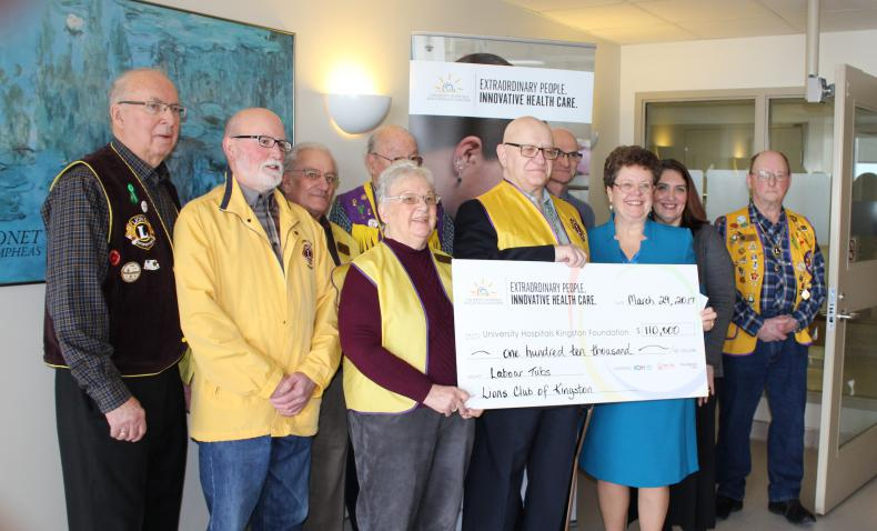Members of the Lions Club present UHKF President & CEO Denise Cumming with their $110,000 donation to KHSC