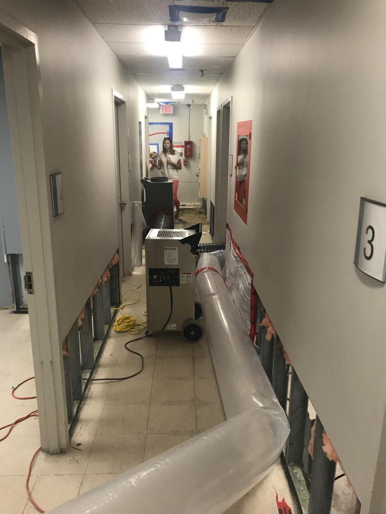 Infection Control staff monitoring humidity levels
