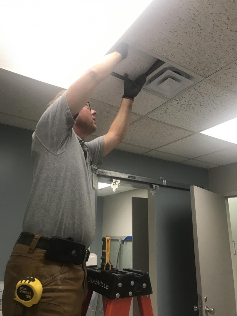 installing new ceiling tiles