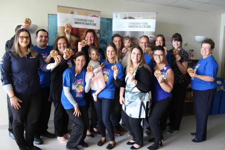 KHSC and UHKF staff along with former NICU patients and Tim Hortons owners kick off the smile cookie campaign