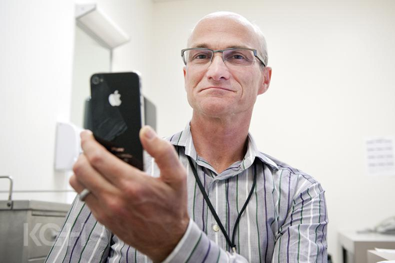 Dr. Graeme Smith in his clinic at KGH using one of his apps.