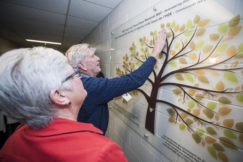 Family members were invited to place the names of their loved ones on the new memorial wall.