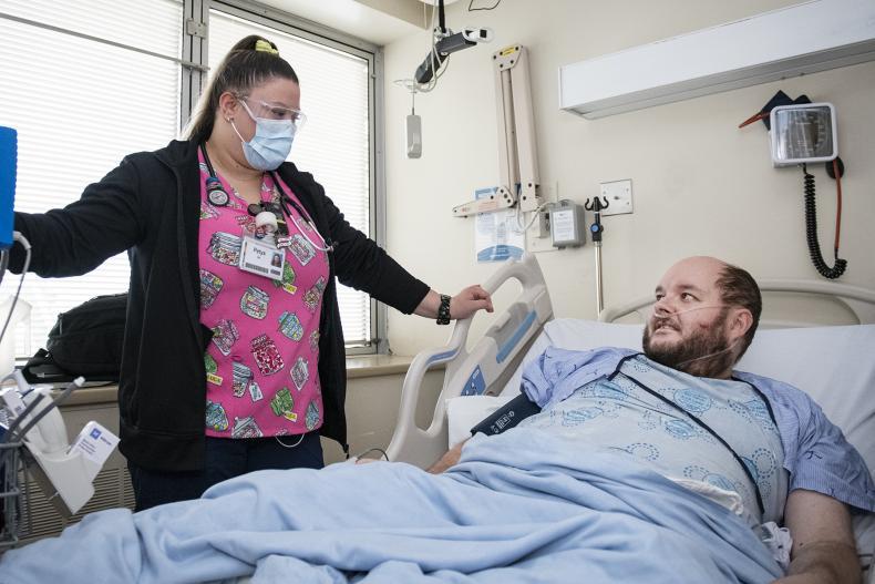 Allworth with nurse in KHSC Covid unit