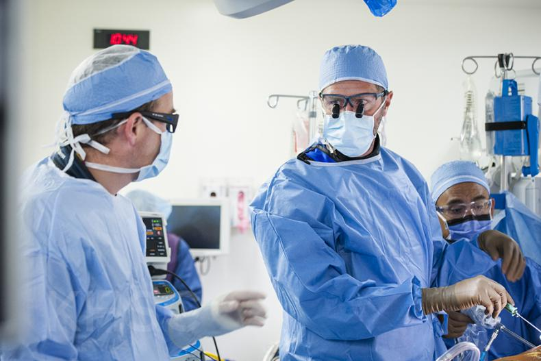 Cardiac surgeon, Dr. Gianluigi Bisleri (R) works along side cardiologist, Dr. Ben Glover (L) during the procedure at KHSC.