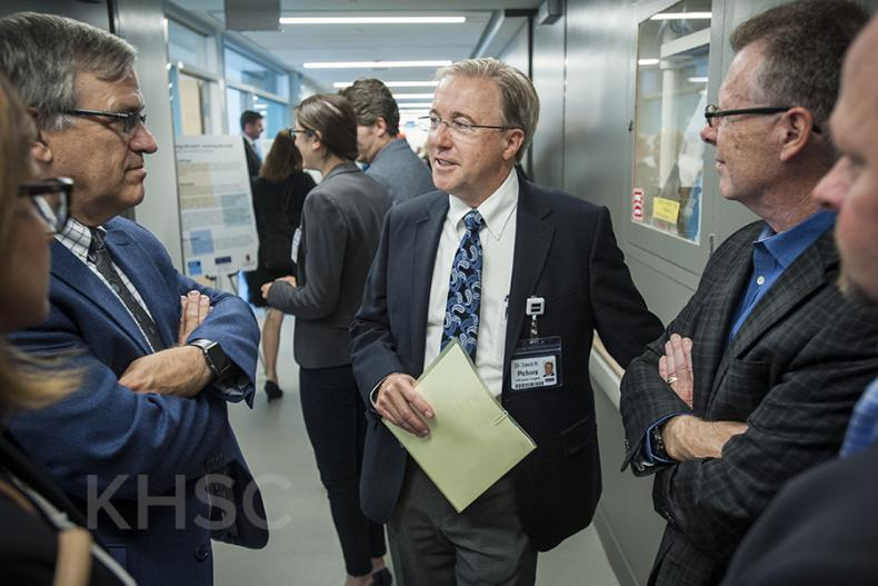 KHSC CEO Dr. David Pichora speaks with individuals touring the new centre
