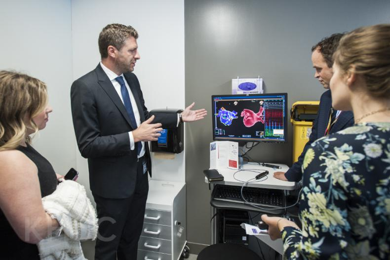 Dr. Gianluigi Bisleri and Dr. Ben Glover show their research to visitors during the grand opening