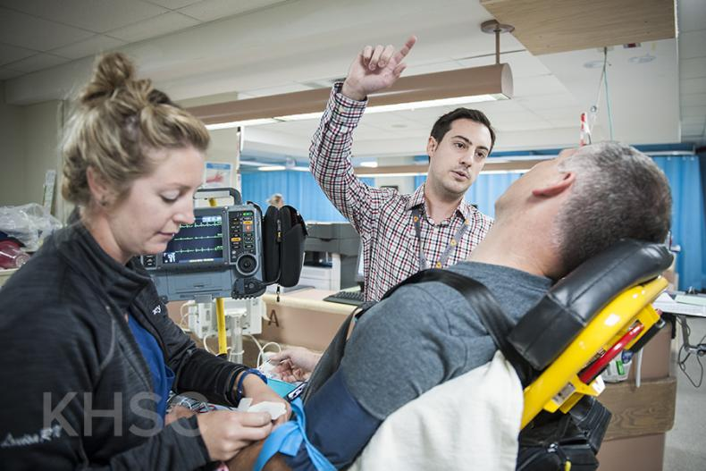 KHSC staff and physicians with with a mock patient in the Emergency Department during an EVT simulation case