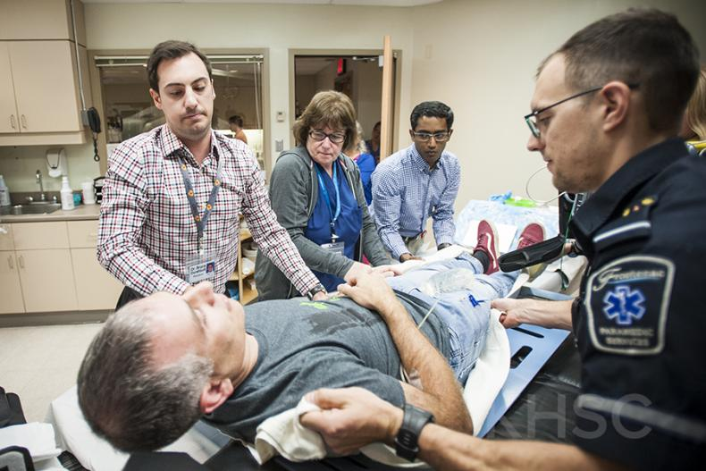 KHSC staff and physicians along with Frontenac Paramedic Services participate in an EVT simulation case