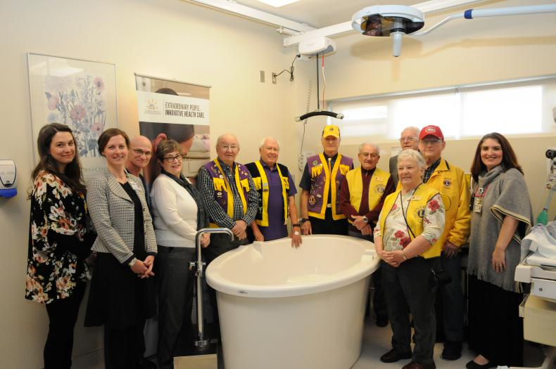 Members of the Lions Club and KHSC's labour and delivery team unveil the new tubs