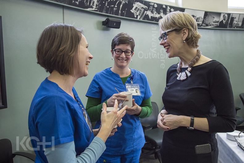 Leslee Thompson chats with staff during a brief farewell event at KGH.