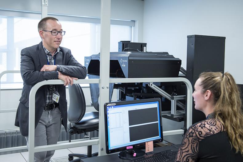 Dr. Gord Boyd and PhD candidate Jessica Vanderlinden with the KINARM in the W.J. Henderson Centre for Patient Oriented Research.