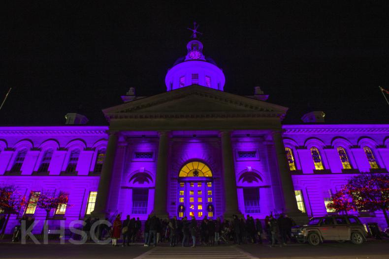 Kingston City Hall is illuminated by purple lights to recognize World Prematurity Day