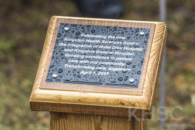 A plaque marks the spot in City Park where a tree will be planted to mark the integration of KGH and Hotel Dieu