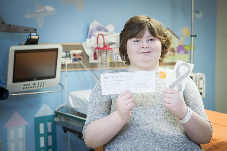 Former patient Carly sold candy in support of KHSC pediatric oncology patients