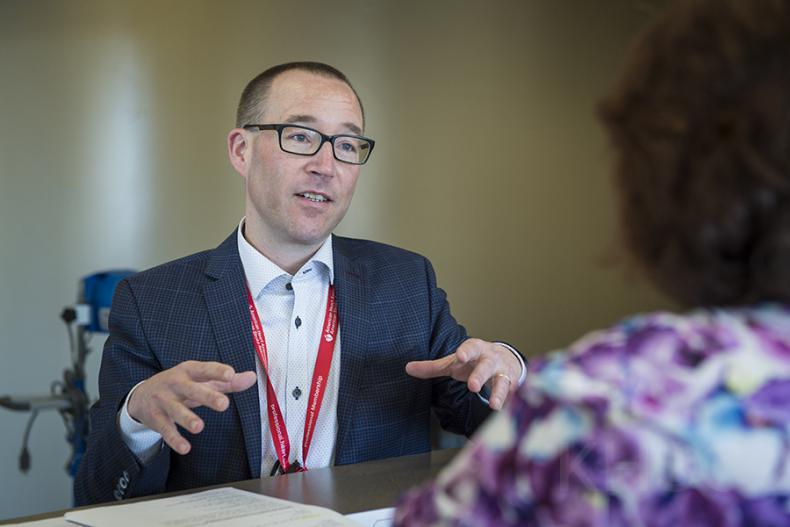Dr. Gord Boyd meets with patients at the three and 12-month mark after their discharge from the hospital as part of their delirium care