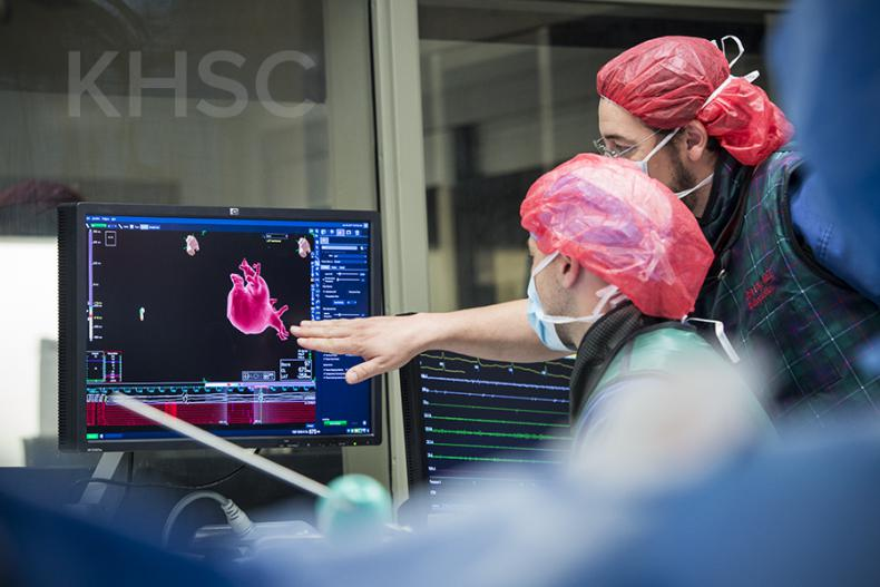Support members from the team monitor various aspects of the procedure throughout the process.
