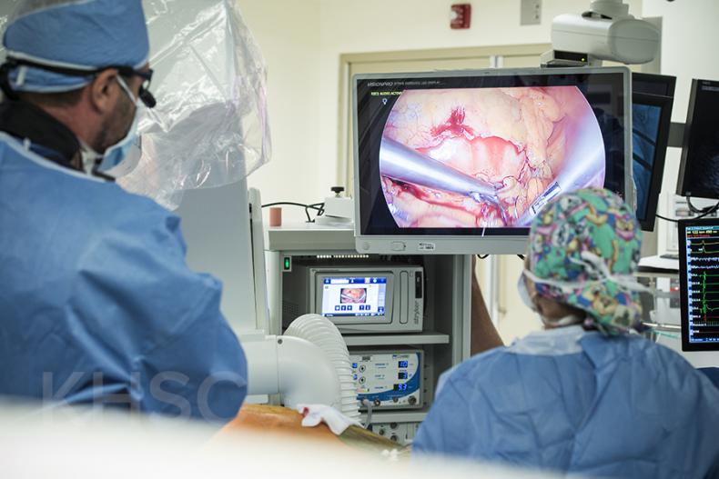 Cardiac surgeon, Dr. Gianluigi Bisleri (L) can see where he is working on the monitors inside the operating suite at KHSC.