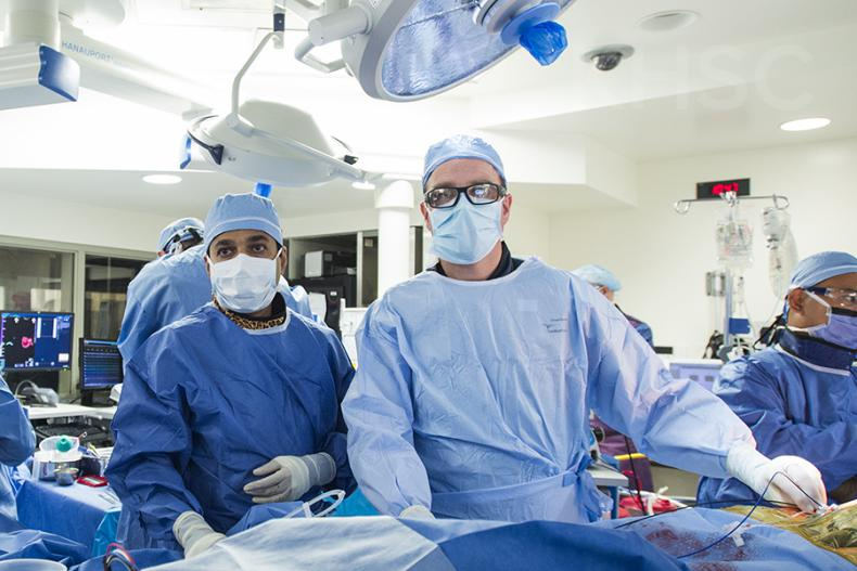 Cardiologist, Dr. Ben Glover (R) works at the patients' side during this hybrid ablation procedure at KHSC.