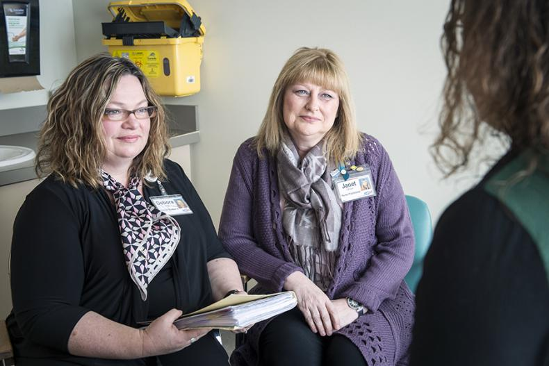 Clinic staff meet with patients to discuss their sexual health